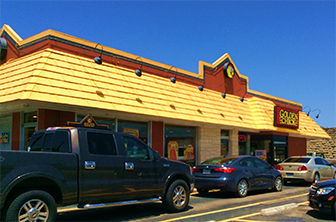 Golden Chick storefront.  Your local Golden Chick fast food restaurant in Georgetown, Texas
