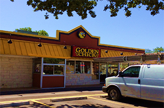 Golden Chick storefront.  Your local Golden Chick fast food restaurant in Round Rock, Texas