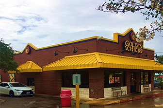 Golden Chick storefront.  Your local Golden Chick fast food restaurant in Kyle, Texas
