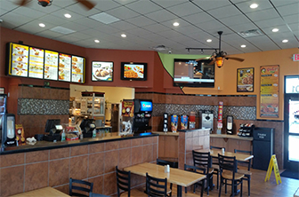 Golden Chick storefront.  Your local Golden Chick fast food restaurant in Burleson, Texas